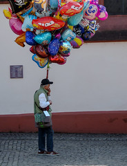 Single street vendor (A. Yousuf Kurniawan) Tags: singel streetvendor people balloon job minimalism minimalist streetphotography colourstreetphotography urbanlife decisivemoment wall