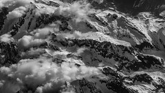 Over the Alps (andbog) Tags: sony alpha ilce a6000 sonya6000 emount mirrorless csc sonya oss sel 1650mm selp1650 sonyα aerialview overlook flight sky airplane airlines volo sonyalpha sony⍺6000 sonyilce6000 sonyalpha6000 ⍺6000 ilce6000 apsc landscape paesaggio panorama widescreen italy italia alpi alps mountain it monochrome biancoenero blackandwhite bw bn 169 16x9 googlenikcollection silverefexpro2 valleaosta valledaosta ridge ridgeline cresta nuvole clouds nature natura