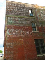 Ghost wall in Burlington, Iowa #2 (jimsawthat) Tags: smalltown burlington iowa downtown brick ghostsign vintagesign cocacola