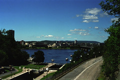 Attractions Along the Ottawa River (pmvarsa) Tags: summer 2000 analog colour film 135 kodak kodakroyalgold400 royalgold 400iso nikonsupercoolscan9000ed nikon coolscan cans2s canon ftb canonftb classic camera sky trees grass blue green parliament hill building galleries museums bridge river water boats street cloud architecture ottawa ontario canada gatineau québec capital region