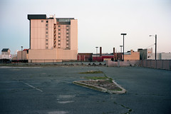 (patrickjoust) Tags: fujica gw690 kodak portra 160 6x9 medium format 120 rangefinder c41 color negative film cable release tripod long exposure dusk blue hour manual focus analog mechanical patrick joust patrickjoust atlantic city new jersey nj usa us united states north america estados unidos urban street highrise building empty parking lot cracked pavement broken