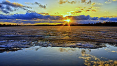 Winter finally relinquishes it's grip on the Lake (Bob's Digital Eye) Tags: april2018 bobsdigitaleye canon canonefs1855mmf3556isll flicker flickr frozenlake h2o ice lake lakesunset lakescape landscape spring2018 t3i water laquintaessenza sunset sky clouds reflections icepack