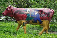 """Til The Cows Come Home (Trish Mayo) Tags: publicschoolgarden cows sculpture art inwood gardens communitygarden"