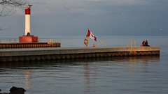 Evening at the lake.jpg (remiklitsch) Tags: spring evening lake pier ontario oakville harbour waterfron lighthouse flag canada red white people nikon remiklitsch couples