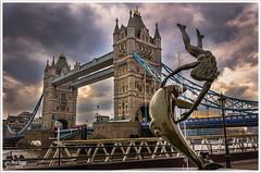 Girl with a Dolphin Fountain (PixelRange) Tags: nikond7000 nikkor18300mm sanjaysaxena riverbank cityscape towerbridge london towerbridgelondon thamesriver bridge cloudyday historicbridge londonicon iconicpicture rivershore water architecture pixelrange girlwithadolphinfountain dolphin towerbridgedolphinsculpture dolphinsculpture david wynne davidwynne