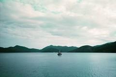 (Instagram: @halloloes) Tags: film analog 35mmfilm hongkong asia sea ferry 35mm analogue landscape nature mountain disposablecamera grain lofi boat