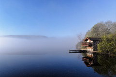 Boathouse Reflections, Ullswater, Cumbria, England (vincocamm) Tags: lake ullswater cumbria pooleybridge morning mist misty fog water trees reflection boathouse jetty landing sunny sun fells lakedistrict nationalpark nikon d5500 landscape blue