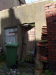 Lean door (Nekoglyph) Tags: staithes yorkshire village urban alley walls brick tiles roof outhouse outsidetoilet door wooden ruined green shadow sunlight chimney wheeliebin hinges red blue leaning noparking