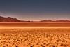Far in the distance ........ (flowerikka) Tags: car desert distance dünen dunes earlymorning landscape linien mountains namib namibdesert namibrand namibsandsea namibia nature rocks sky valley