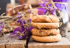 Oat cookies with raising and chocolate on purple flowers background. Healthy food concept. (alena.alekseeva.rudenko) Tags: cookies oat oats chocolate cookie oatmeal food healthy flowers breakfast snack purple lilac raisin sweet homemade wooden dessert closeup baked eating pastry bakery cereal vegan raisins rustic tasty biscuit gourmet background