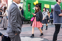 Toughening Up Her Image (burnt dirt) Tags: asian japan tokyo shibuya station streetphotography documentary candid portrait fujifilm xt1 laugh smile cute sexy latina young girl woman japanese korean thai dress skirt shorts jeans jacket leather pants boots heels stilettos bra stockings tights yogapants leggings couple lovers friends longhair shorthair ponytail cellphone glasses sunglasses blonde brunette redhead tattoo model train bus busstation metro city town downtown sidewalk pretty beautiful selfie fashion pregnant sweater people person costume cosplay pink red orange black green