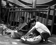 Happiness (magiceye) Tags: happiness street streetphoto streetportrait bananas vendor pavement mumbai india monochrome blackandwhite bnw