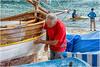 we are preparing for summer ...man at work ...( 2 ) (miriam ulivi - OFF /ON) Tags: miriamulivi nikond7200 italia liguria sestrilevante baiadelsilenzio barche leudo boats manatwork uomoallavoro spiaggia seaside people mare sea streetphotography