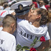 A Sailor hugs his family upon the ship's return from a scheduled deployment.