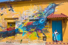 Cartagena street art (ABWphoto!) Tags: southamerica colombia cartagena art mural color colorful streetart portrait posing photograph photography streetphotography graffiti painting bird woman one