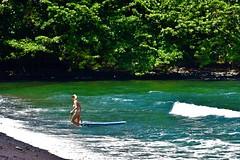 High tide (thomasgorman1) Tags: tide surf surfer woman bikini nikon hawaii island shore hilo honolii surfing nature scenic sea ocean wave colors natural forest trees green