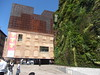 CaixaForum Cultural Centre and Vertical Garden, Paseo del Prado, Madrid (d.kevan) Tags: spain madrid culturalcentres verticalgardens plaza formerpowerstation 1900 2008 architecturaldetails plants posters people flowers decorativedetails caixaforum