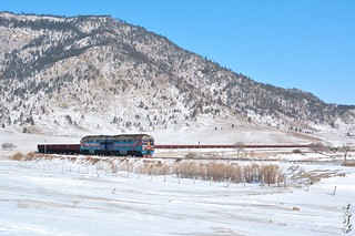 2TE116UD-075 with freight train.