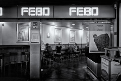 Heads Against The Wall (Alfred Grupstra) Tags: people blackandwhite men editorial indoors travel transportation station restaurant urbanscene passenger febo snack
