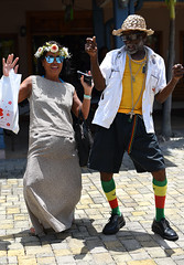 Let Da Riddum Move Yuh Gyal! (Poocher7) Tags: people portrait male female dancing reggaedancing reggaemusic music jamaica mobay montegobay westindies caribbean tourist jamaican palmleafhat shoes reggaesocks reggaebelt cross chains yellowbodyshirt whiteshirt dress asianlady sunglasses flowers shoppingbag