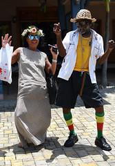 Let Da Riddum Move Yuh Gyal! (Anthony Mark Images) Tags: people portrait male female dancing reggaedancing reggaemusic music jamaica mobay montegobay westindies caribbean tourist jamaican palmleafhat shoes reggaesocks reggaebelt cross chains yellowbodyshirt whiteshirt dress asianlady sunglasses flowers shoppingbag
