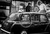 The Black Cab Coffee Co (garryknight) Tags: sony a6000 on1photoraw2018 london allrightsreserved themonoseries monochrome blackandwhite 50mmf18 bricklane market man coffee drink cab taxi black blackcab street candid mono