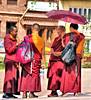 Tibetan Monks huddling in the sun. (jillrowlandwv) Tags: nepal kathmandu adventure red colorful tourist travel tourism canon canonphotos canonphotography street flags prayerflags temple monks city animal monkey