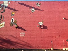 Fowl Play (misterbigidea) Tags: shadows evening cartoon urban city funny flying fowl red brick art mural painted restaurant wall bbq chicken