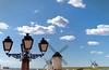Campo de Crriptana (chelocatala) Tags: farolas molinos cielo nubes azul