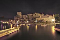 Collioure, France (morejoefotog) Tags: fortress boats harbor night