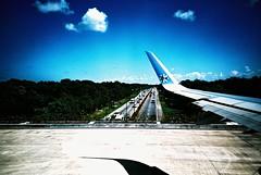 Cancun (cranjam) Tags: lomo lca lomography film slide xpro expired kodak elitechrome100 mexico messico cancun quintanaroo yucatán airport aeroporto cun interjet airplane aeroplano aereo bridge ponte