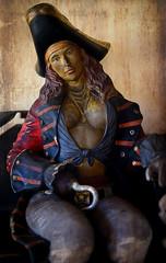 Sista Hook (Anthony Mark Images) Tags: pirate female statue art femalepirate hook captainhook bandana cleavage jamaica caribbean caribbeanpirate blueeyes long longhair goldchains bench shoppesatrosehall mobay montegobay piratesofthecaribbean sundaylights