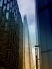 High tech buildings (Adobe Garamond) Tags: london high tech technology buildings modern glass ominous rainbow colours vivid photosjop