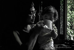 Coffee moment with daddy! (stormymayen) Tags: coffee baby dad moment bonding window bw darkkey dim light caring cute parenthood