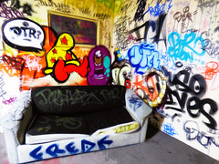Take a Seat Freak (Steve Taylor (Photography)) Tags: freak dtr dtrcrew jacobyikes yikes morpork wongi sofa split graffiti mural streetart tag seat colourful newzealand nz southisland canterbury alien monster christchurch spectrum ymca