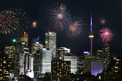 Victoria Day Fireworks in Toronto Downtown (Katrin Ray) Tags: victoriadayfireworks torontodowntown victoriaday may212018 lastmondaybeforemay25 bluehourfireworks downtown cntower bluehour fireworks lights colours longexposure composite fireworksatashbridgesbay bluehourindowntown photomontage toronto ontario canada katrinray dreamscapesoftoronto night canon canonphotography eos rebel t6i 750d