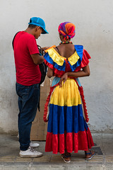 Cartagena Conversation (Packing-Light) Tags: colombia cartagena southamerica colorful street people dress conversation