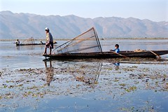 Magical Places and Things - Inle Lake (7) (The Spirit of the World ( On and Off)) Tags: children boys fishermen lake inlelake hills fishing boats oars paddles everydaylife burma myanmar asia water waterscape rowboat