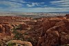 Walking on Top of a Sandstone Fin and Savoring the Views of a World Beyond! (Arches National Park) (thor_mark ) Tags: archesnationalpark azimuth35 blueskies blueskieswithclouds butte canyonlands capturenx2edited centralcanyonlands colorefexpro coloradoplateau day7 desert desertlandscape desertmountainlandscape desertplantlife desertvegetation devilsgardenloop devilsgardenlooptrail devilsgardentrail devil'sgardentrail fincanyon highdesert intermountainwest junipertrees landscape largebushes layersofrock lookingne mesa nature nikond800e outside partlysunny portfolio project365 rockformations sandstonecanyonwalls sandstonefin sandstonewalls sunny trees utahhighdesert utahnationalparks2017 ut unitedstates absolutelystunningscapes