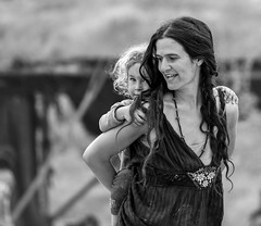 """When you are with me, I can face any challenge!"" (ybiberman) Tags: israel desert festival rainbowserpentfestival mother girl carry carryontheback walking necklace portrait candid streetphotography people bw"