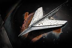 Stud (ISP Bruno Laplante) Tags: 1955 studebaker commander old chrome classic car vintage black rust decay hood ornament