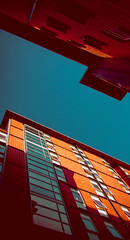 Quay Framing (C. E. Kingsley-Jones) Tags: nikon 70200 architecture building golden hour brayford quays sky orange blue film processing punch colour window facade highrise framing perspective urban vintage retro