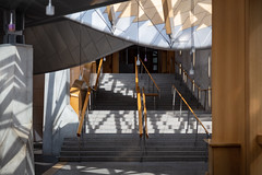 Scottish Parliament Tour May 2018 (62 of 119) (Philip Gillespie) Tags: scottishparliament visitscotparl scotland parliament edinburgh canon 5dsr architecture windows lights tour seats flags dog pets water interior design hills arthurs seat city sky sun art sculpture mono monochrome colour color black white blue green red yellow orange stairs boat style curves lines chamber epmg photography meetup group people men women boys girls kids chambers meetings summer grass trees