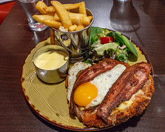 Birthday dinner. Chicken schnitzel with hot chips plus bacon, a fried egg and Hollandaise sauce. (garydlum) Tags: chicken friedegg chickenschnitzel hollandaisesauce hotchips bacon eggs macquarie australiancapitalterritory australia au