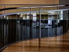 Glass Panels (Steve Taylor (Photography)) Tags: curving curvy balcony christchurchartgallery architecture black white glass metal newzealand nz southisland canterbury christchurch city curve lines reflection rail railing wood wooden panels silver brown grey artgallery