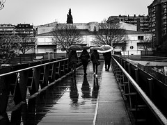 Under the rain yes, but singing?... (muntsa-joan-BW) Tags: rain bridge blackandwhite bw barcelona granollers street streetphoto streetphotography city calle ciudad