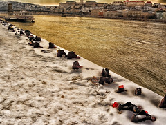 Shoes on the Danube Bank (tcees) Tags: idantalljózsefrkp budapest hungary pest danuberiver cantogay gyulapauer memorial urban shoes iron sculpture nikon d5200 1855mm winter cold freeze freezing water flower candle snow snowing footprints boat jetty pier buildings chainbridge buda budacastle holocaust