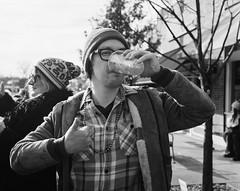 Erik (BurlapZack) Tags: pentax6x7 smcpentax90mmf28 ilfordhp5plus oakclifftx dallastx spinsterrecords mardigras parade hurricane booze drink beer thumbsup portrait bokeh dof film analog 120film mediumformat bw mono monochrome sidewalk bystander crowd audience chug goodtimes greatoldies glasses alcohol beads