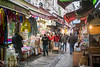 A busy narrow street with outdoor marketplace selling various goods, Istanbul Spice bazaar (Remsberg Photos) Tags: bazaar market souk spice istanbul turkey city urban egyptianbazaar commerce business retail shopping exchange commodities vendor forsale street marketplace storefront selection products goods standing outdoor covered traveldestination middleeast consumerism awning metropolitan citylife outdoormarket economy