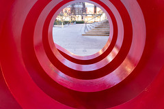 Red tunnel to Robson Square (Margeaux Nicholas) Tags: robsonsquare vancouver art circles city light red spiral tube tunnel urban sculpture abstract